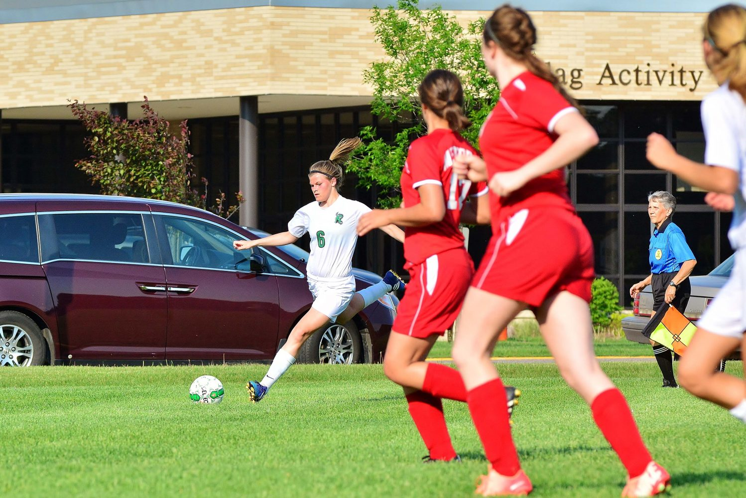 Hannah Eggers moves the ball to the center.