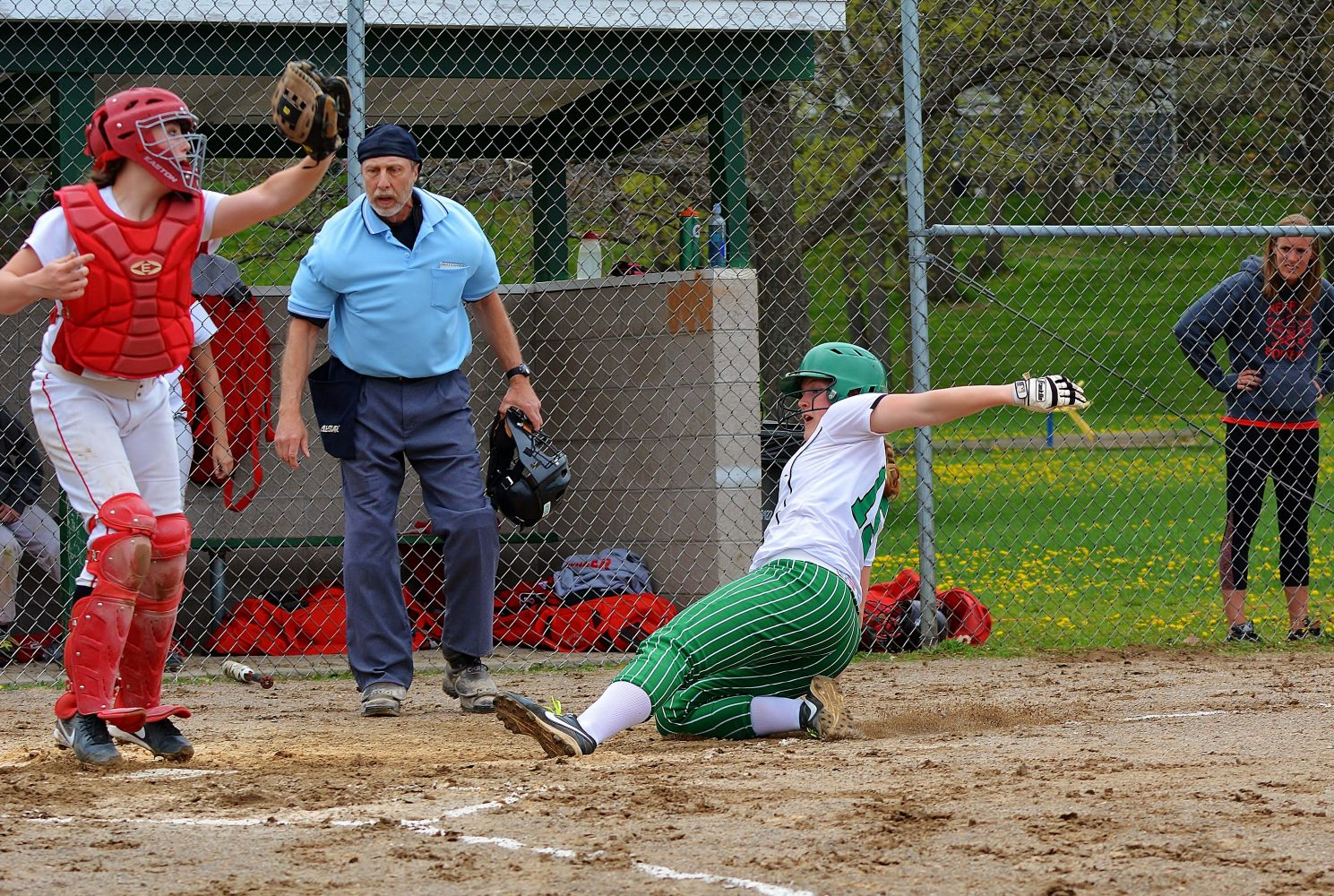 Molly Wagler slides in under the tag.