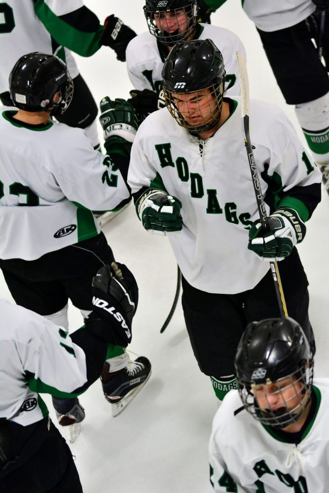 Henry Kipper celibrates with teammates after one of his two goals on the night.