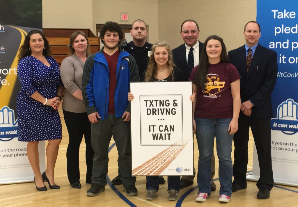 Students at Three Lakes High School learned about the dangers of distracted driving during an It Can Wait event at the high school hosted by AT&T, AAA and the Wisconsin State Patrol.  Pictured left to right, Robyn Gruner of AT&T; Theresa Nelson of the Department of Transportation; student Chase Kirby; Sgt. Bryan Wrycha with the Wisconsin State Patrol; student Brooke Stefonik; State Senator Tom Tiffany; student Madalyn Sowinsk and Principal Gene Welhoefer.