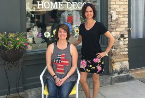 Store owner Tricia Novak, seated, and Jennifer Sturzl planned ahead for the downtown street reconstruction by featuring sales and discounts throughout the summer and into fall.