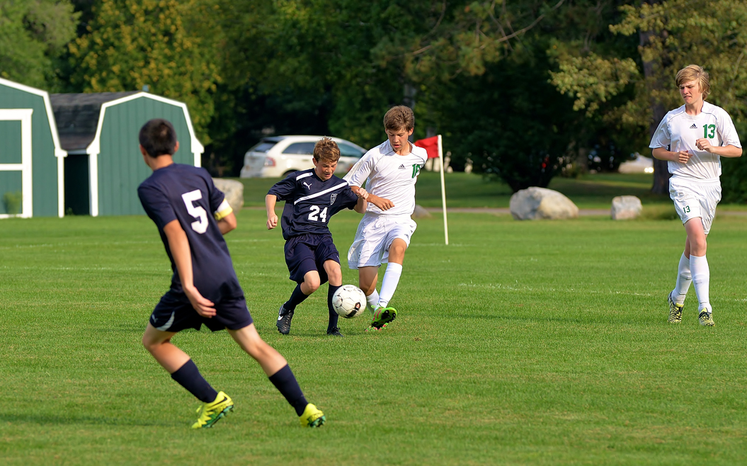 Harrison Shinners works to take control of the ball. Ryan Roberts looks to help.