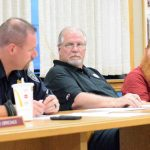 From right, Rhinelander City Council members Steve Sauer and Tom Gleason listen to police chief Michael Steffes during Monday's council meeting. Sauer and Gleason have been accused by council president George Kirby of violating the city ethics code and by council member Mark Pelletier of violating the state's Open Records Law after releasing performance review forms they filled out about recently terminated former city administrator Kristina Aschenbrenner. Photo by Kevin Boneske