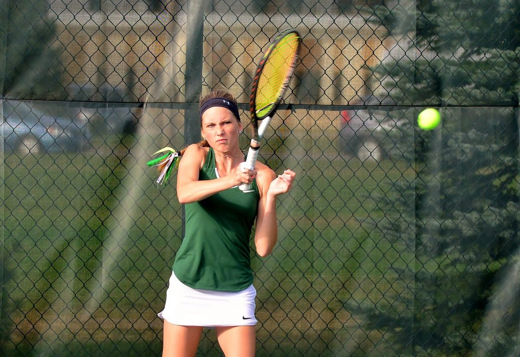 The Hodags' Ivy Packard hits a shot in Tuesday's home tennis meet against  Phillips. Packard won her No. 1 singles match in straight sets over Gabrielle Von Seggern, 6-0, 6-0. Photo by TMK Photography