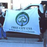 From left, Rhinelander mayor Dick Johns and DNR urban and community forestry coordinator Don Kissinger hold a Tree City USA flag in recognition of the mayor declaring Tuesday as Arbor Day in the city. Photo by Kevin Boneske