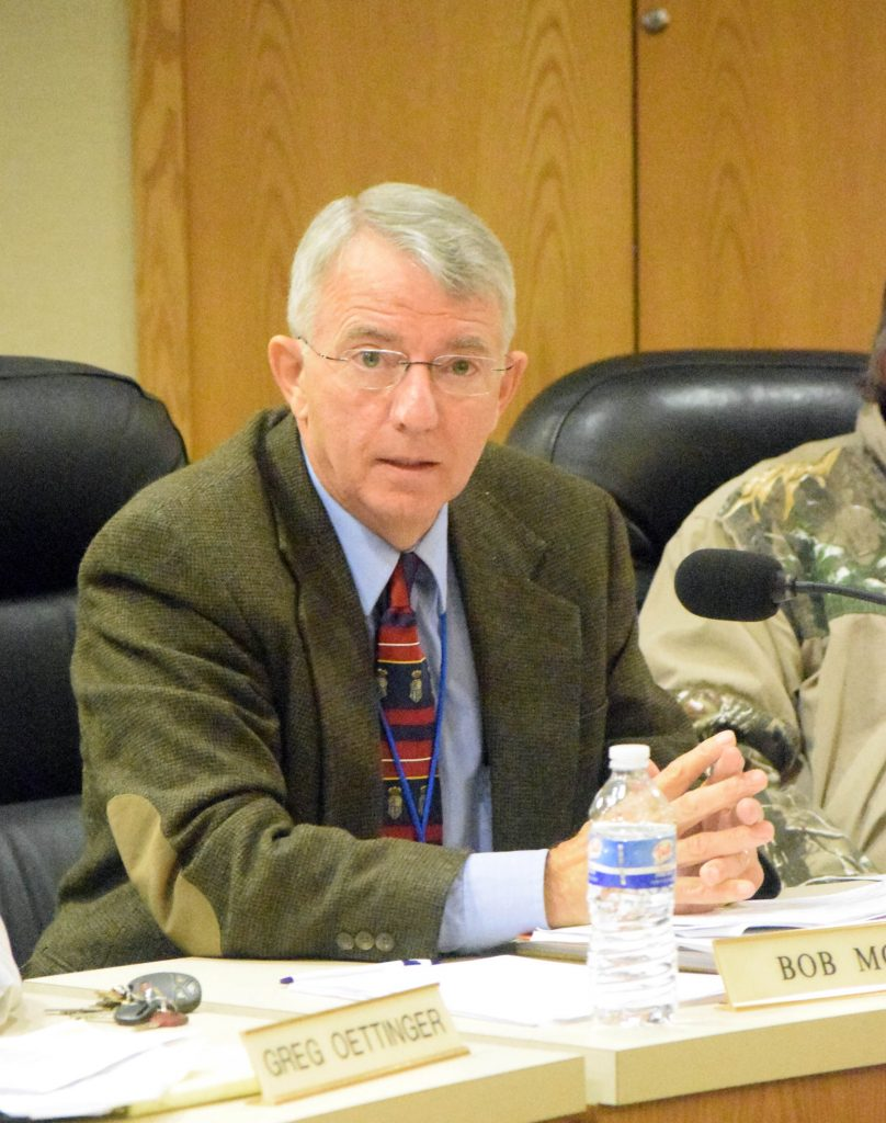 Oneida County supervisor Bob Mott speaks at Tuesday's meeting in favor of a resolution to limit boathouses built in the county to 480 square feet. Photo by Kevin Boneske