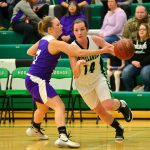At right, the Hodags' Kaly Kostrova (14) dribbles past the Ashland defender. Photos by TMK Photography