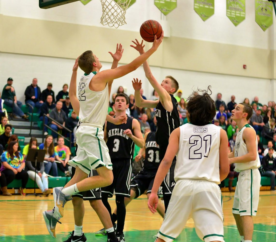 At left, the Hodags' Owen White shoots a reverse layup.
