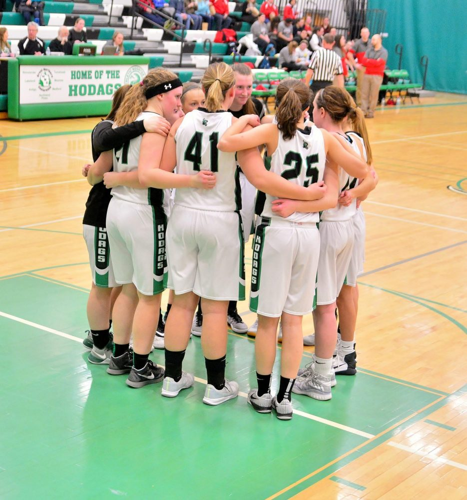 The Hodags huddle on the court.