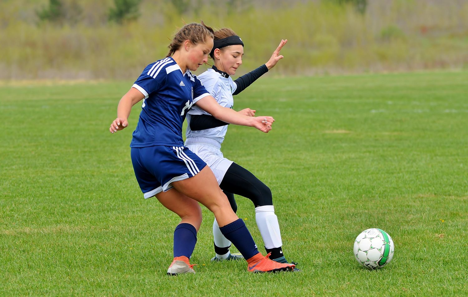 At right, the Hodags' Kenedy Van Zile battles for the ball Saturday against Wausau West.