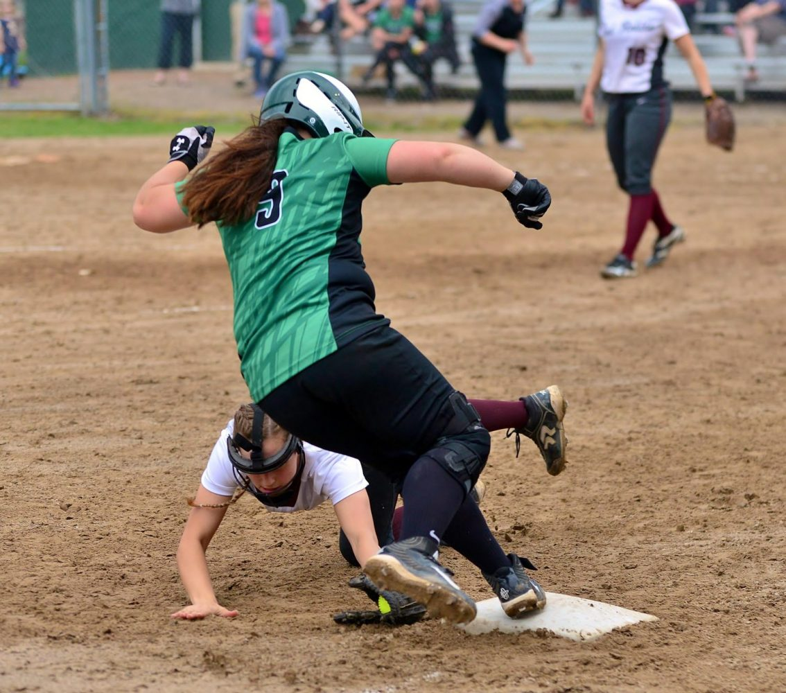 The Hodags' Makayla Kuester (9) steps over the tag at third base in Tuesday's home doubleheader against Antigo.