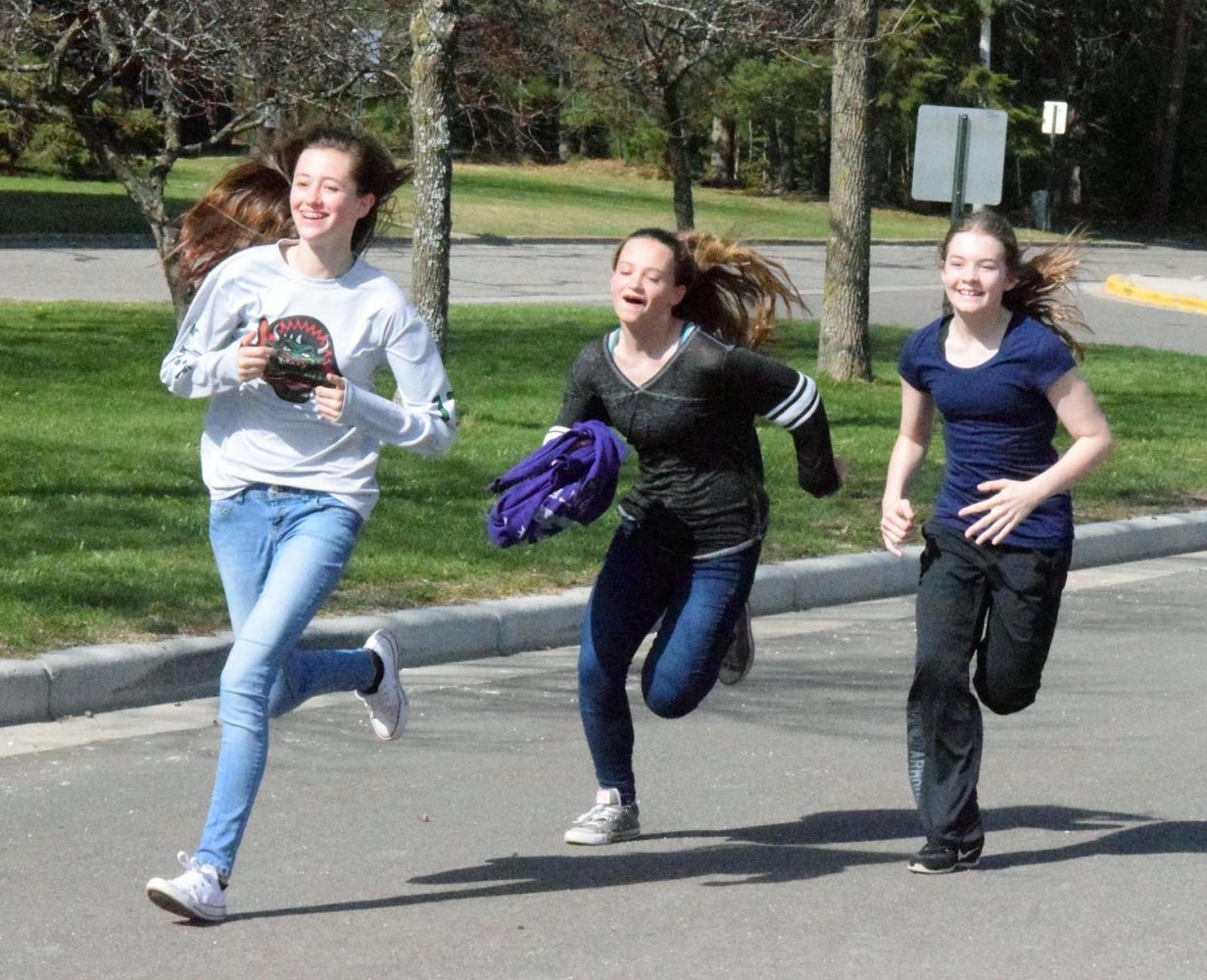 Three girls dash to the finish line Wednesday in James Williams Middle School's annual 3K run.