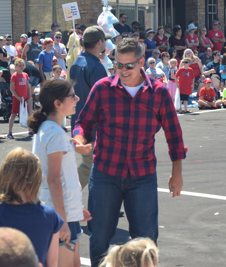 U.S. Rep. Sean Duffy stops to shake hands with a parade-goer.