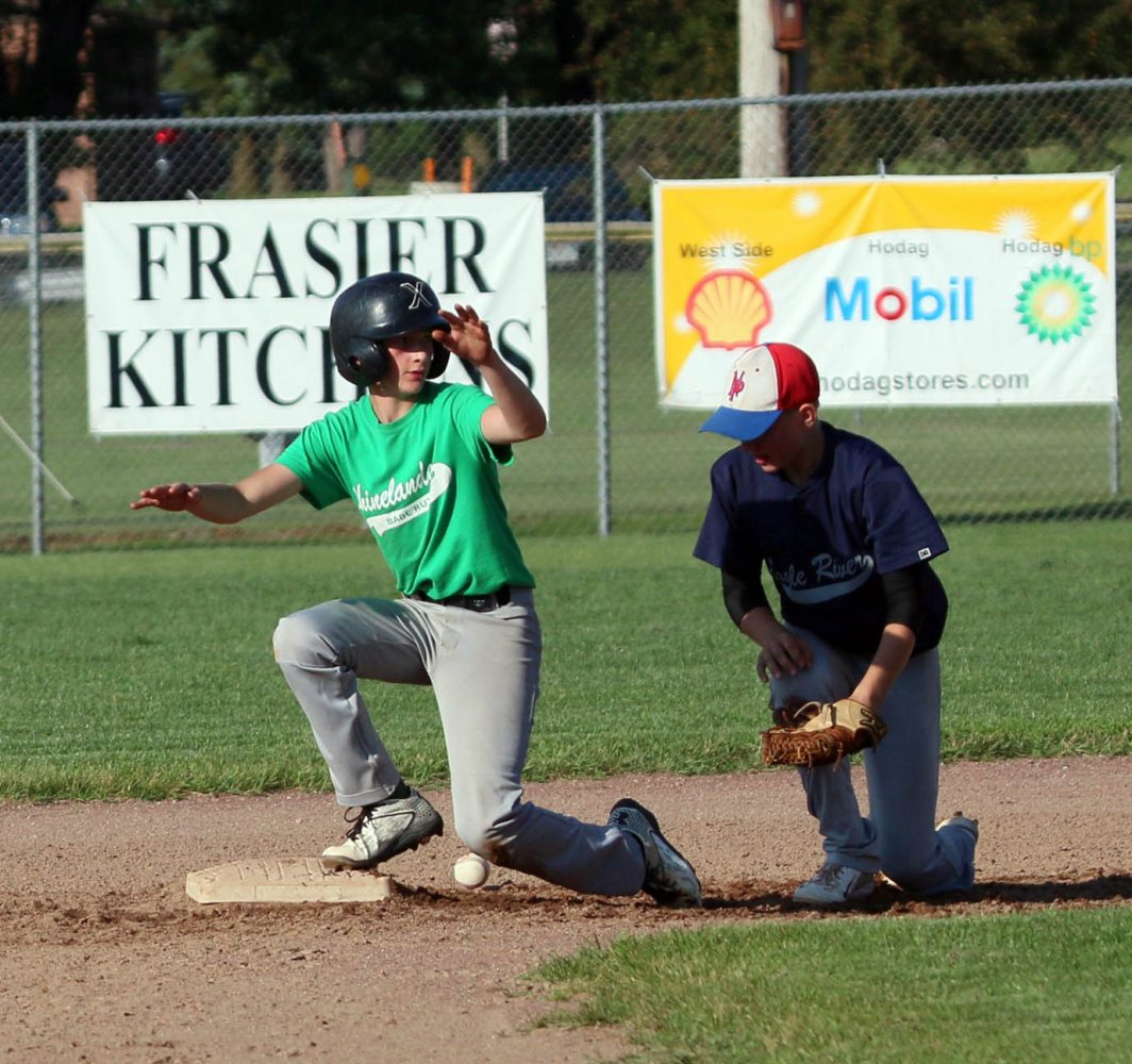 At left, the Rhinelander Preps' Ian Miller is safe at second with a stolen base.