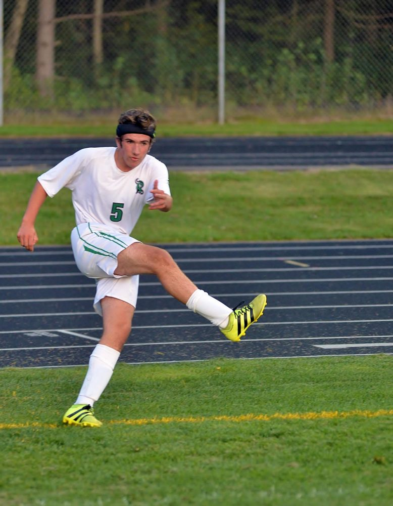 The Hodags' Martin Hoger (5) follows through on a corner kick Tuesday against Antigo.