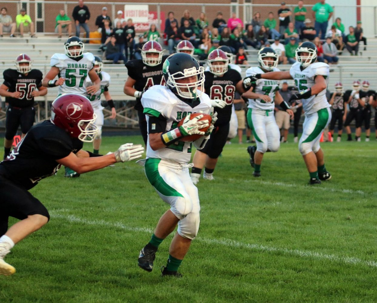 In front at right, the Hodags' Kenny Baumgardner (21) catches a pass in Friday's season openerat Prescott.