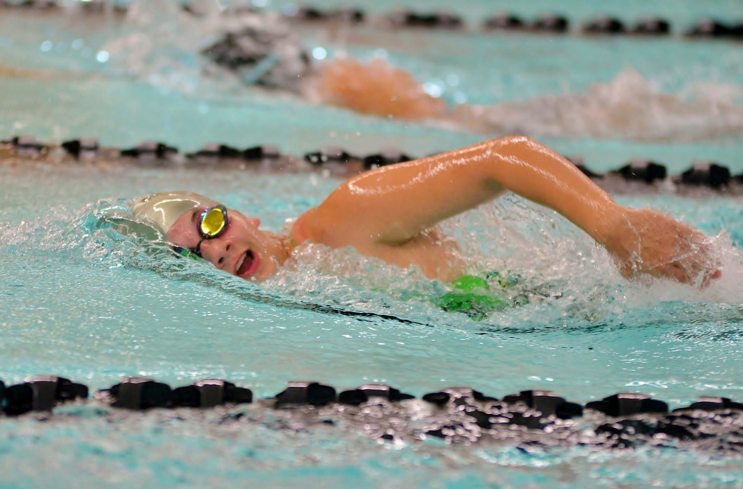 The Hodags' Ella Schiek swims the freestyle in Thursday's home dual meet against Lakeland Union High School.