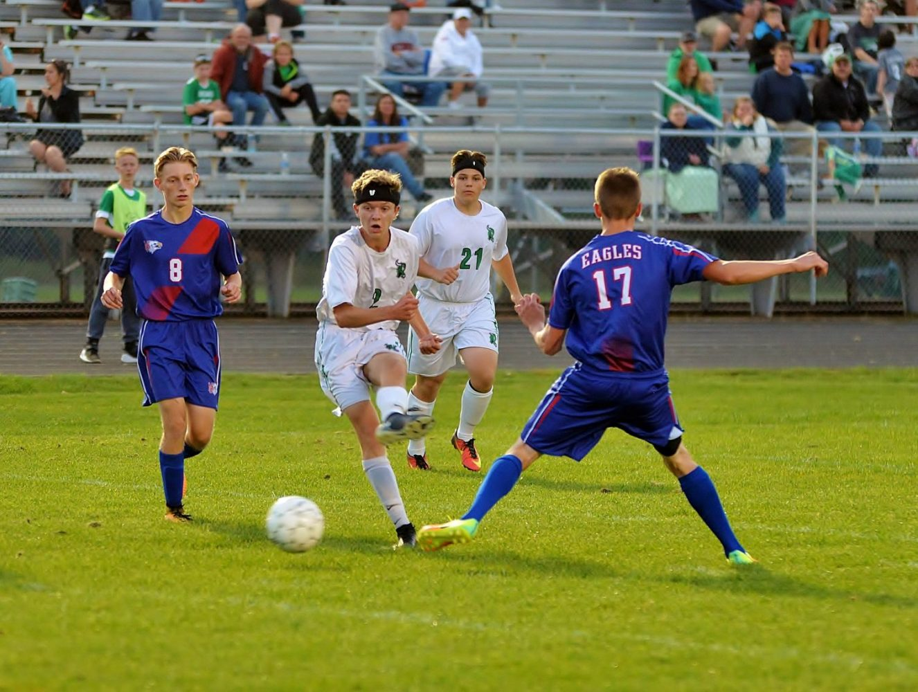 At center, the Hodags' Matthew Von Oepen (2) kicks the ball between Northland Pines players in Tuesday's game at Mike Webster Stadium.