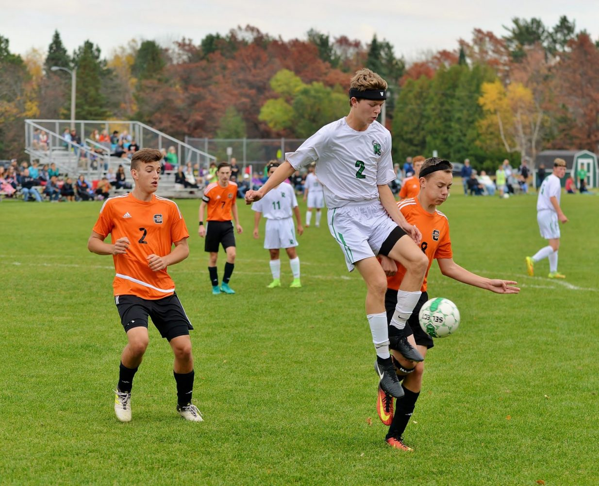At right, the Hodags' Matthew Von Oepen (2) jumps up with the ball in Saturday's WIAA Division 3 Regional title game against Clintonville.