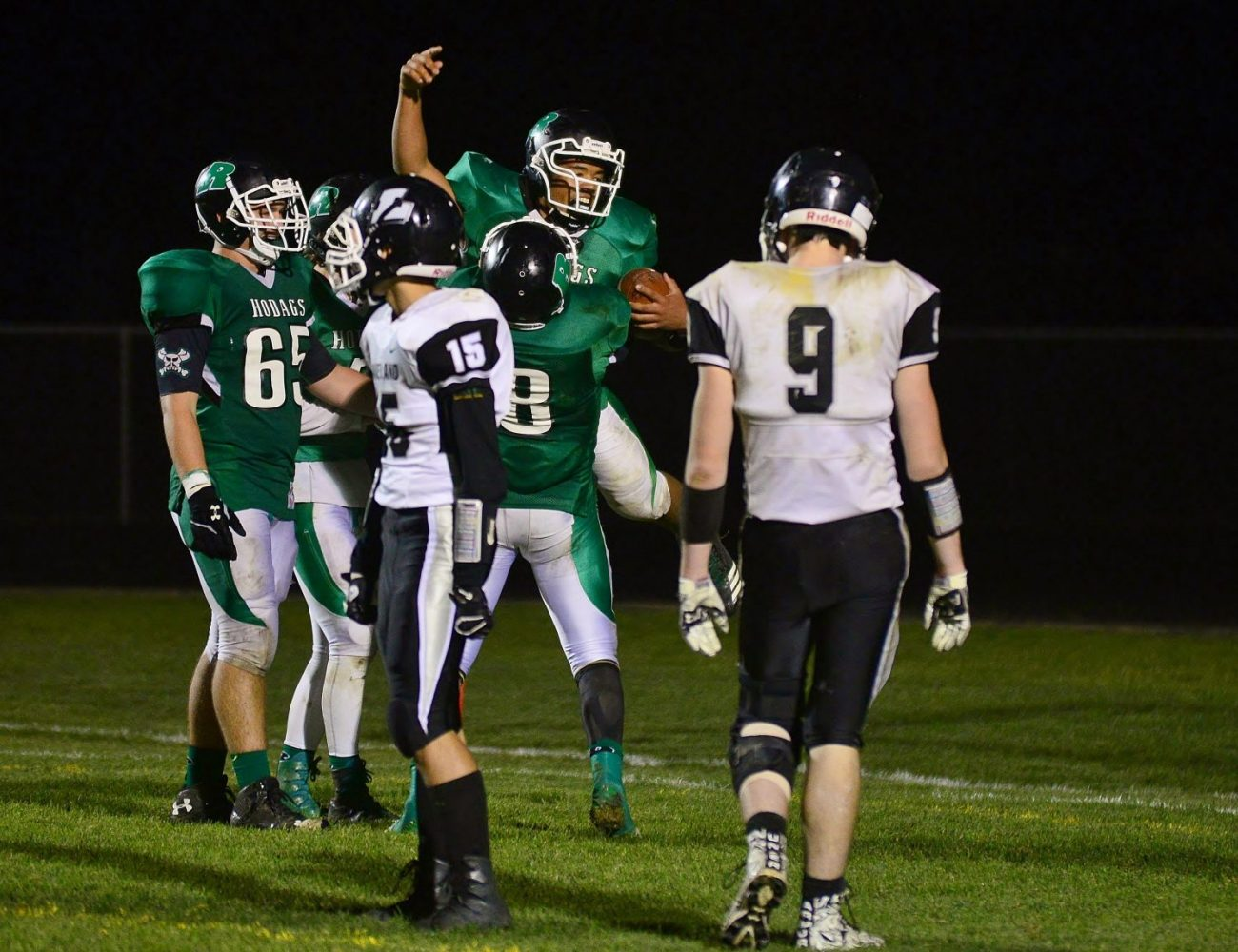 The Hodags' Logan Freund (8) celebrates with Drake Martin in the end zone.