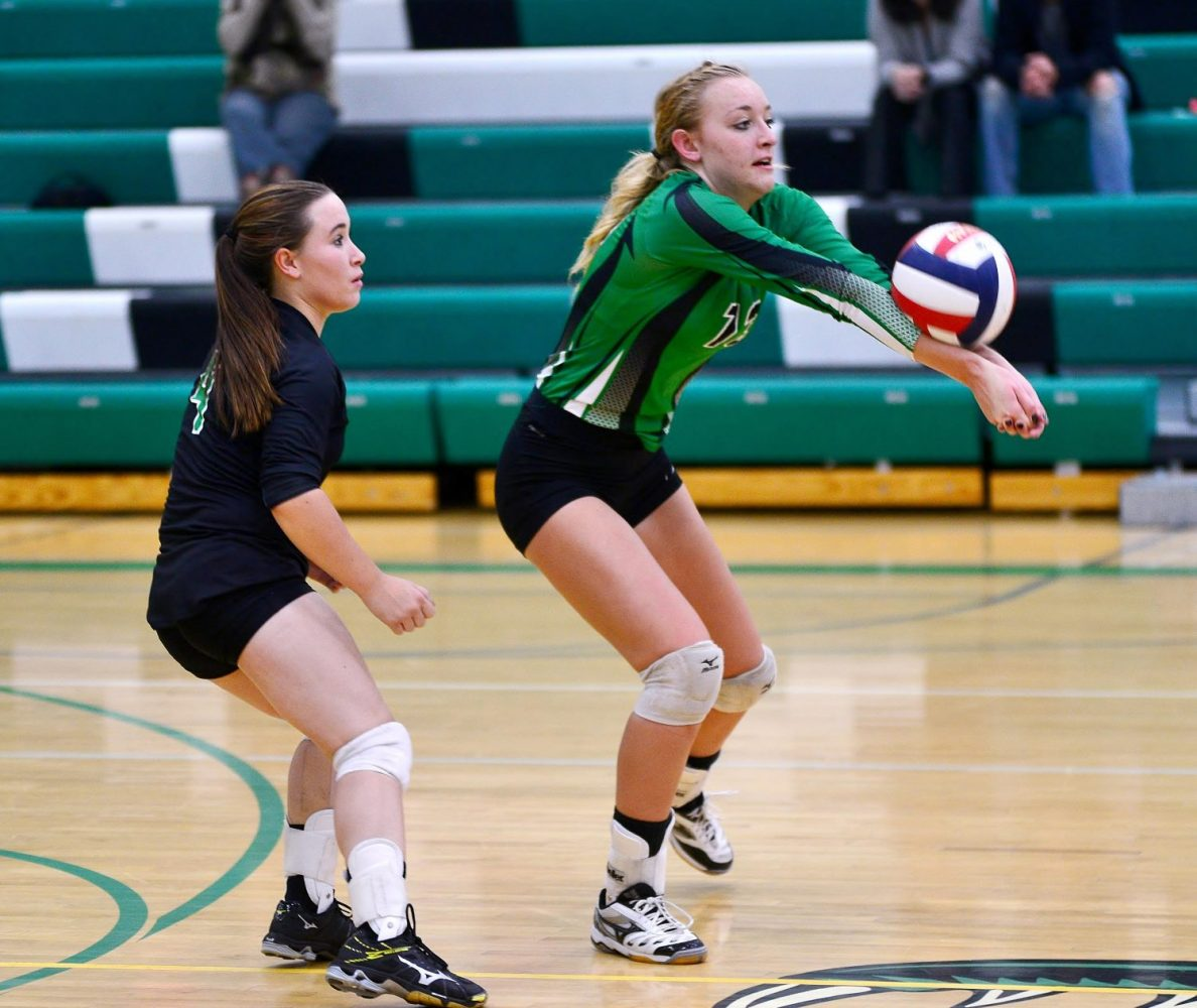 "From right, the Hodags' Hope Wissbroecker (13)  is shown digging out the ball with Stephanie Kuester (4) looking on in the Oct. 10 home match against Medford.  Wissbroecker has been named the Great Northern Conference ""Player of the Year"" with Kuester selected second-team all-conference. Star Journal file photo"