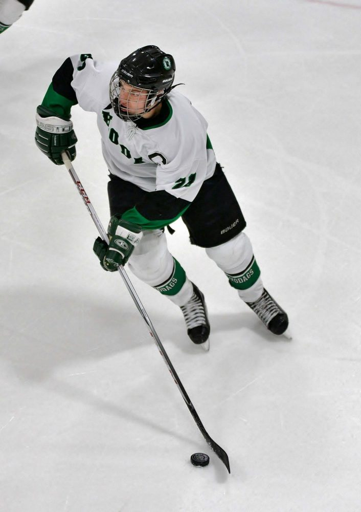 The Hodags' Bridger Flory (21) advances the puck Thursday against Medford.