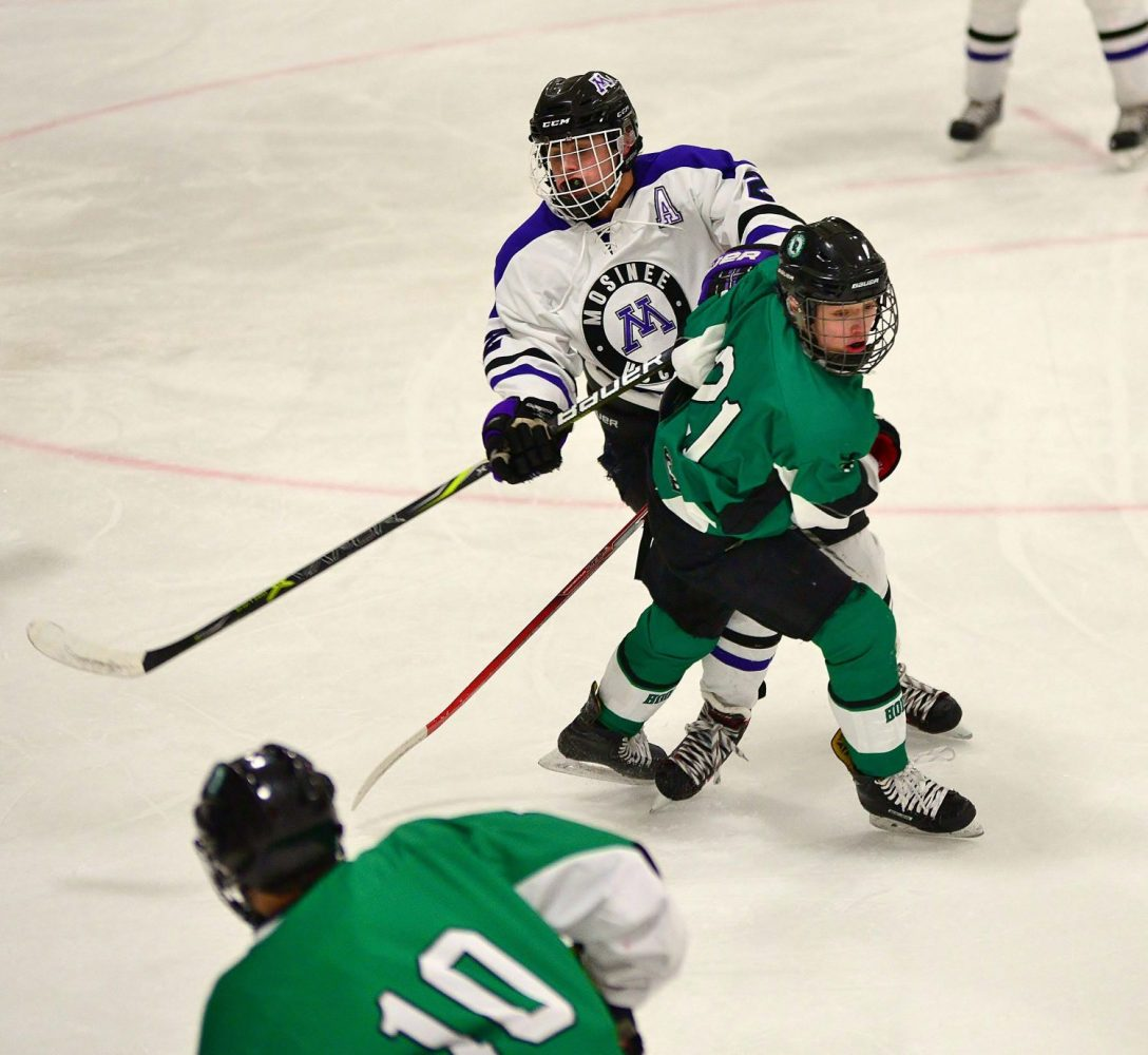 In back from right, the Hodags' Bridger Flory (21) battles with Mosinee's Trey Fitzgerald (2).