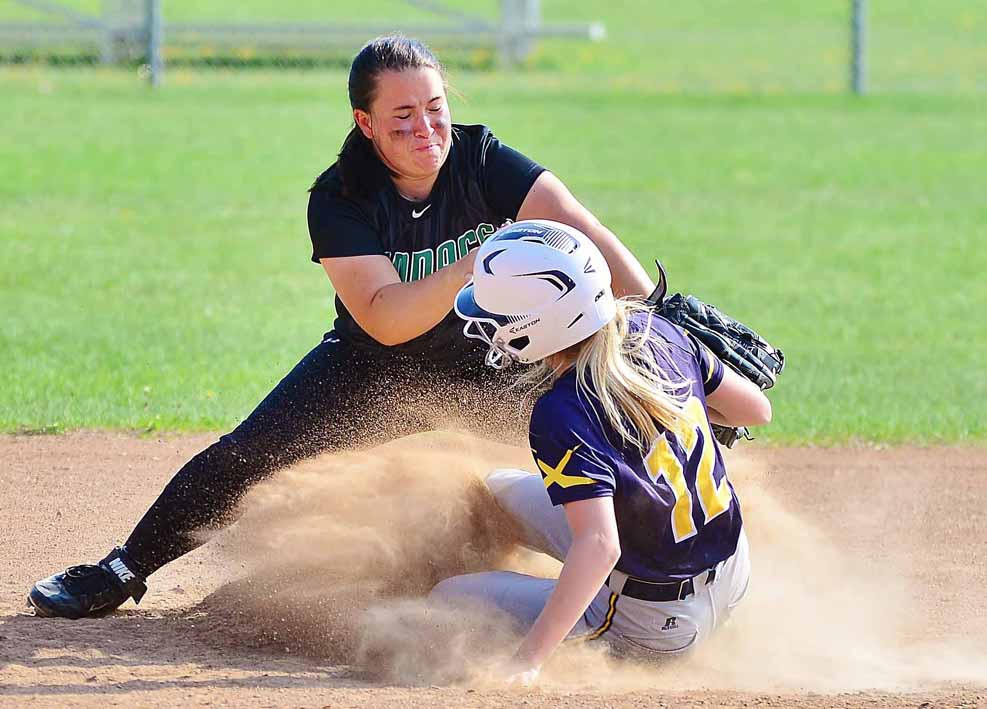 The runner collides with Makayla Kuester.